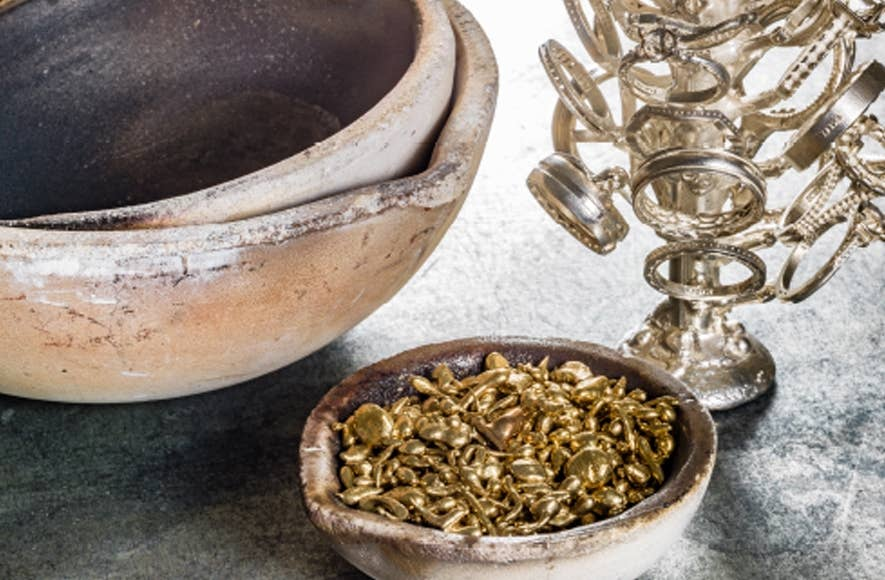 Close up of gold pieces in a bowl