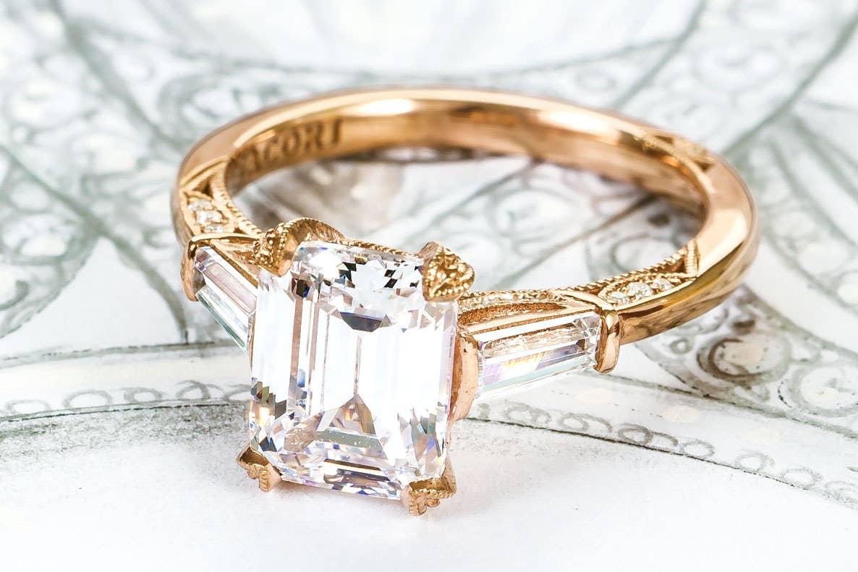 Close up of Tacori's RoyalT bridal rings in gold