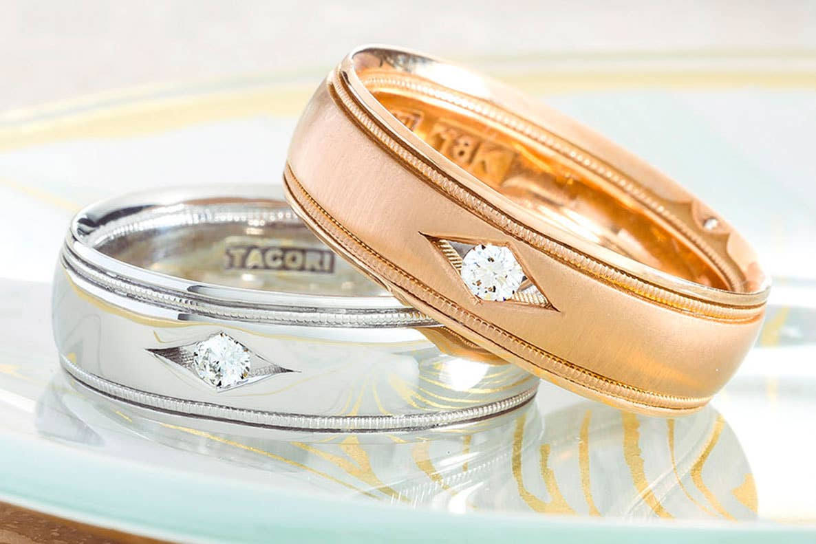 Two Tacori Men's engagement rings stacked on top of each other: one platinum and other white gold