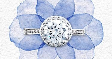Tacori round engagement ring in platinum resting above a watercolor flower