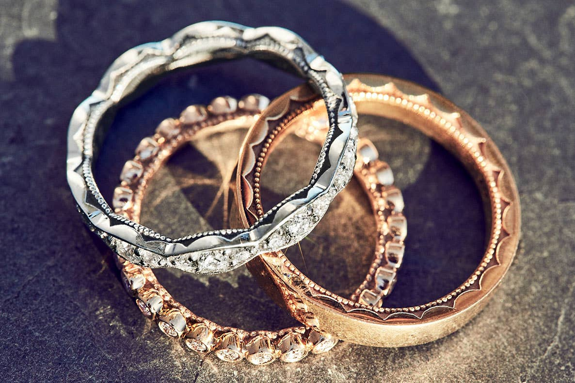 Three women's wedding bands from Tacori stacked on top of each other